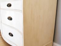 Bow-front antiqued dresser