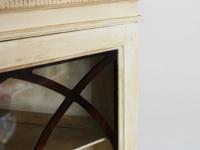 White antiqued corner cabinet