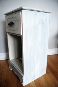 Side view of the milk-painted bedside table