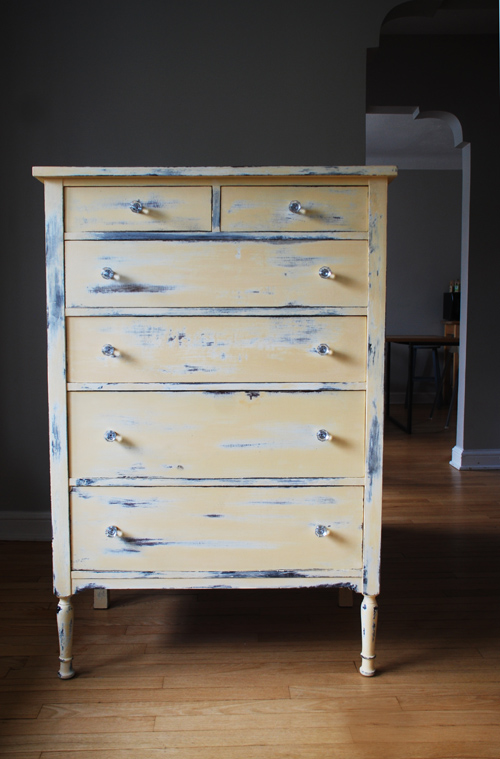 Yellow antique distressed dresser