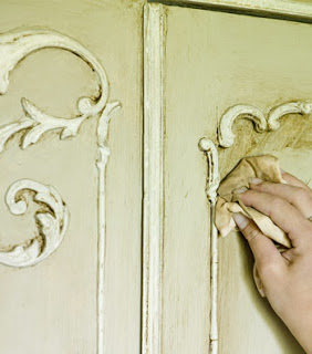 Annie Sloan painting an armoire in Creating the French Look