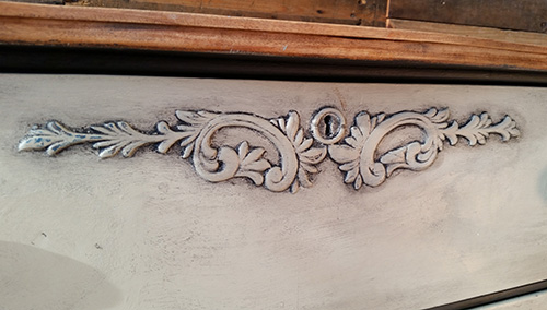 Detail using black wax for antiquing